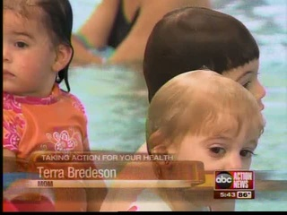 Mom Terra Bredeson with toddlers swimming in pool