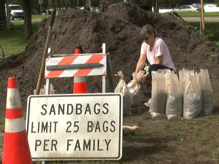 woman filling sandbags