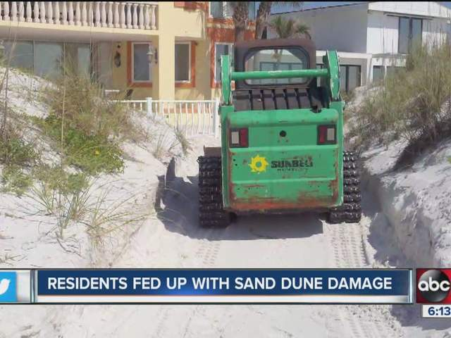 Altering sand dunes behind clearwater beach home being for Abc salon equipment in clearwater fl