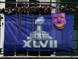 A Super Bowl XLVII flag is seen on Bourbon Street