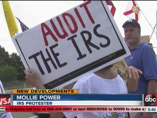 Close to 100 people protest outside the IRS building in Tampa concerned over government overreach