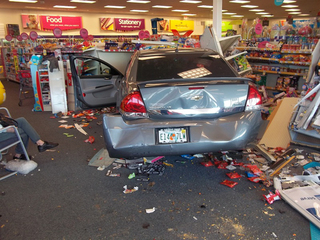 VIDEO: Car crashes into CVS, almost hits woman