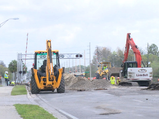 Utility crews fixing reclaimed water pipe