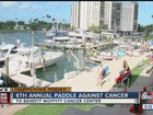 Volunteers paddle their way to battle cancer