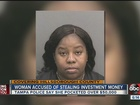 Wife of used car deal accused of scamming