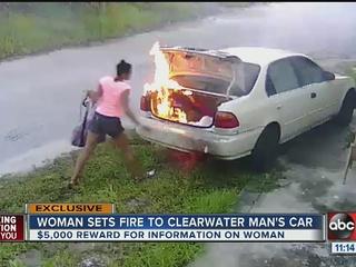 Mystery woman lights man's car on fire