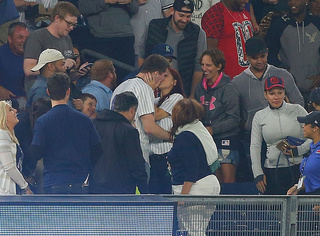 Fan drops ring during Yankee's game proposal