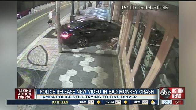 Car crashes through street brawl, into bar, as camera rolls