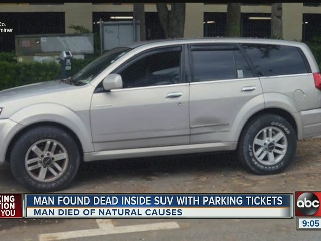Man found dead inside SUV with parking tickets piled on windshield