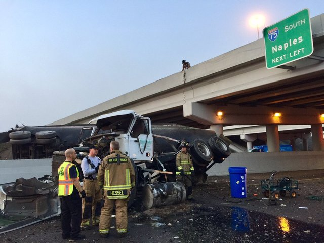 Truck crashes over I-75 overpass, falls onto Fowler