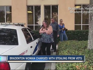 Police: woman pocketed cash donated for veteran