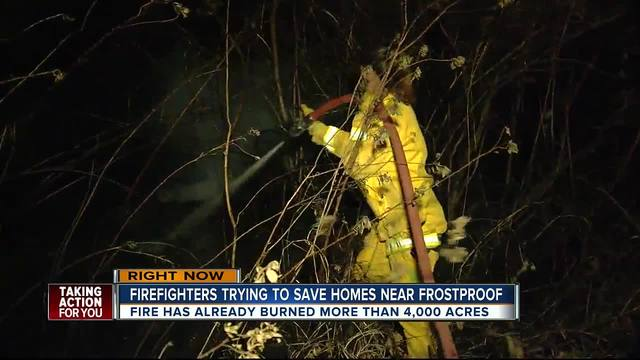 Firefighters trying to save home near Frostproof
