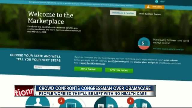 Crowd confronts congressman over Obamacare