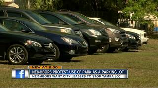 Neighbors protest use of park as a parking lot