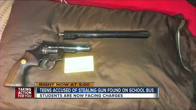 Teens accused of stealing gun found on school bus