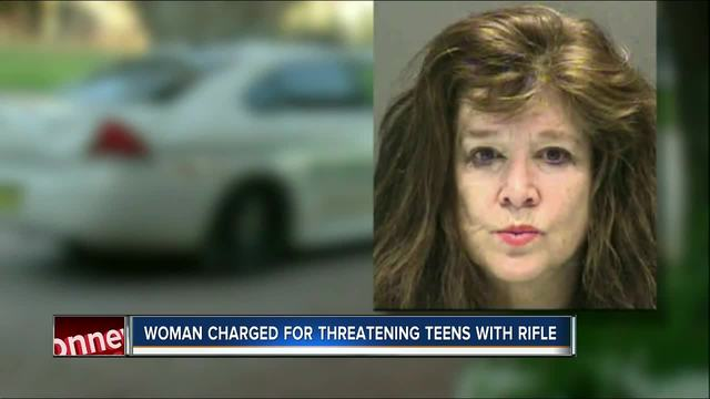 Florida woman accused of pointing rifle at rowing team