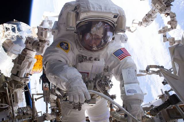 Equipment water leak shortens spacewalk by 2 US astronauts