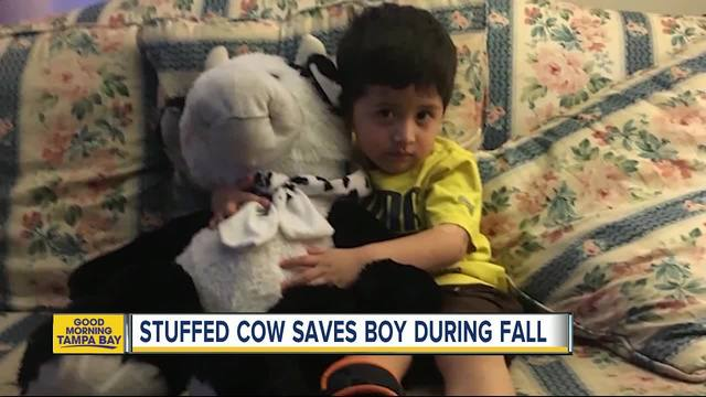 Huge stuffed cow saves 2 year old boy after fall out for 2 year old falls out of window