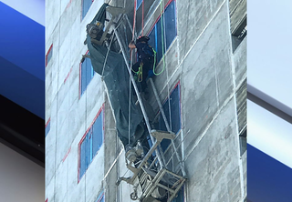 GALLERY: Worker stuck on scaffolding rescued