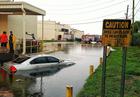 CAUTION: Area can flood in heavy rain;