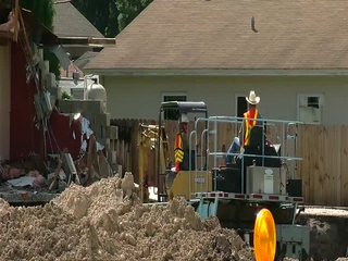 Crews recover cash, documents from sinkhole