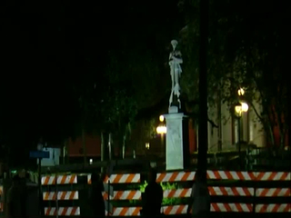 Police stand guard at Confederate statue