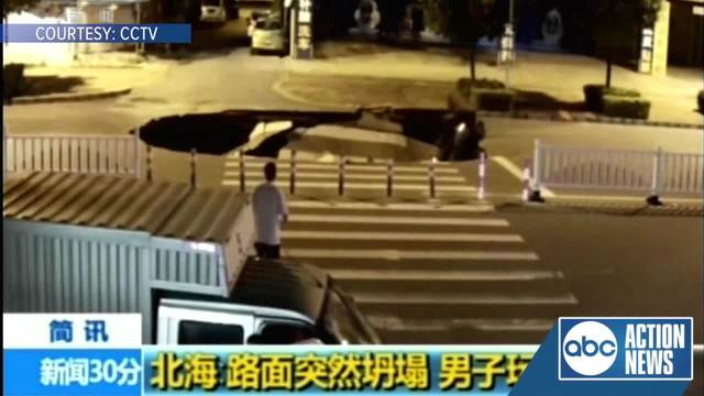 WATCH- Man looking down at phone falls into hole