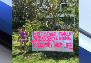 Woman creates sign to get power back on