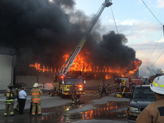 Crews battle 3-alarm fire warehouse in Tampa
