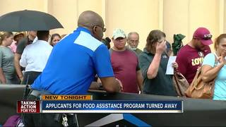 People wait hours for food assistance