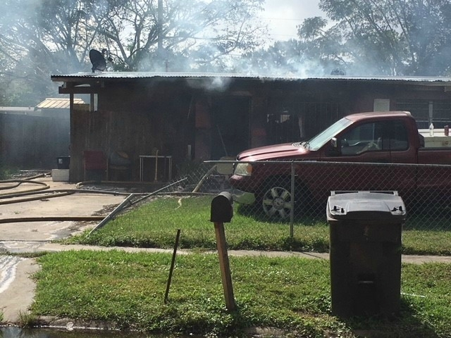 Adult, two children injured in house fire