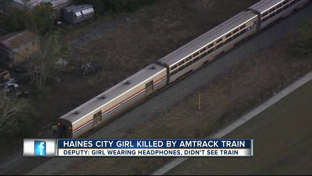 Polk girl, 11, using phone, headphones before train killed her