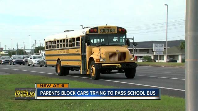 Parents record as drivers don-t stop for school bus along US 19 in Pasco…