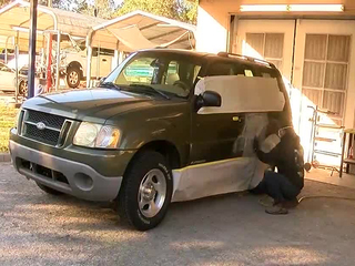 Auto Shop Helps Fix Acid Stain On Womans SUV