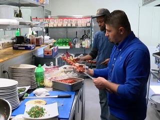 Restaurant cooks thousands of turkeys for needy