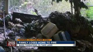 Fire victims say bank tried to take their land