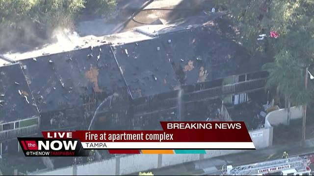 Firefighters battle two-alarm fire at town homes in Tampa