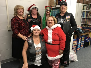 Ladies biker group gives to store for teachers