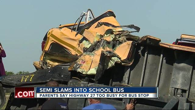 Students taken to hospital after semi slams into school bus