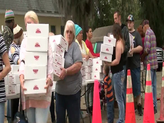 Church gives 60 truck loads of food to needy