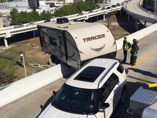 PHOTOS: Camper dangles over I-275 in St. Pete