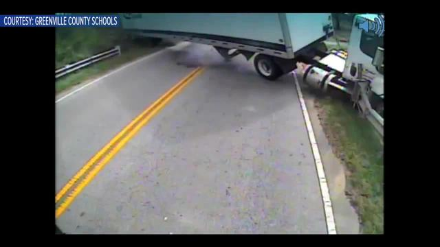Dramatic video shows tractor-trailer hit school bus carrying special…