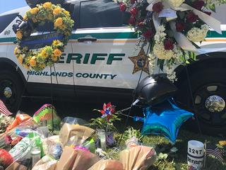 More than 1,000 attend vigil for fallen deputy