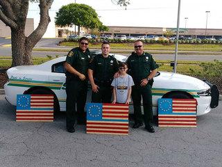 Family crafts flags honoring fallen deputy