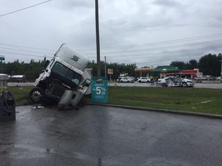 One dead after semi-truck runs red light