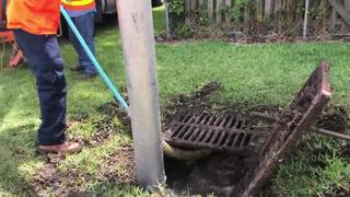 Clearing out storm drains ahead of more rain