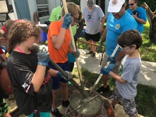 Kids make cement reef balls to help marine life