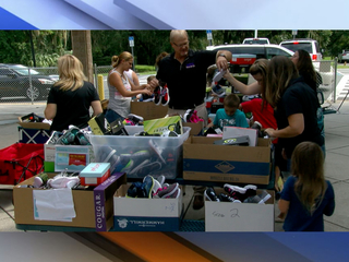 Hundreds of new shoes given to Moton Elementary