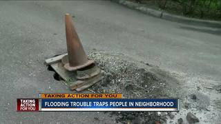 Crews work to stop flooding at mobile home park