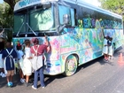 Artist lets kids express themselves painting bus